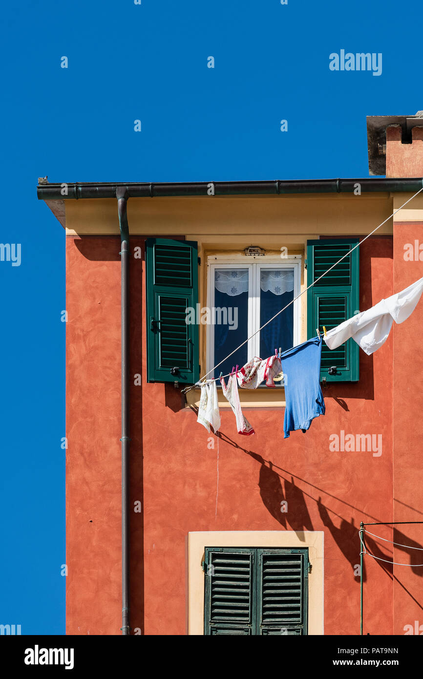 Colorful house detail and clothesline, Camogli, Liguria, Italy. - Stock Image