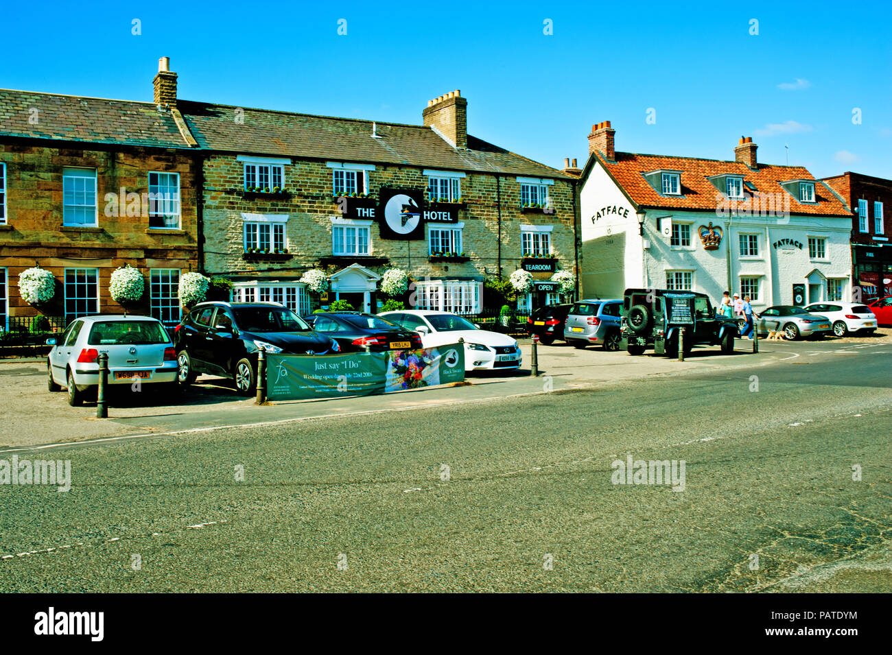 Swan Hotel and Fat face clothes shop, Helmsley, North Yorkshire, England - Stock Image