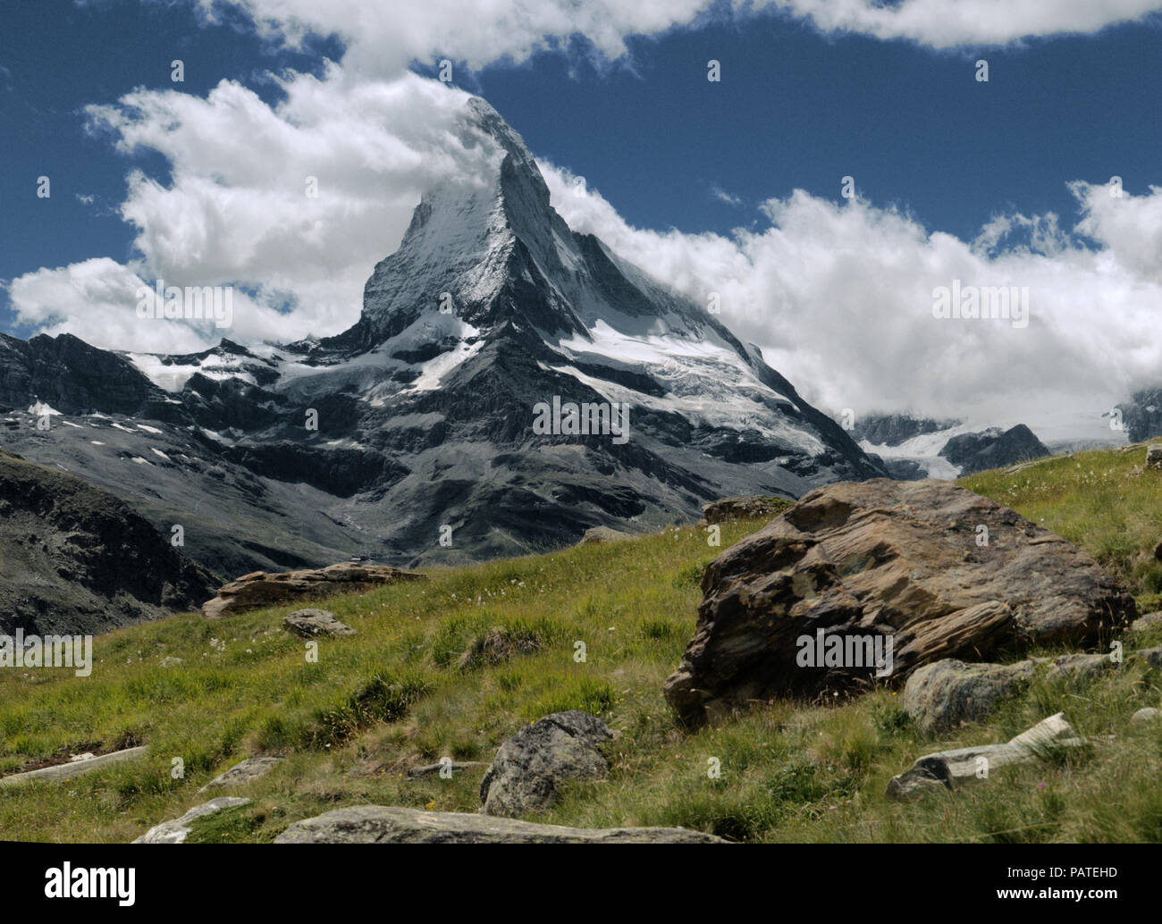 The iconic peak of the Matterhorn seen from Valais, showing banner cloud formation - Stock Image