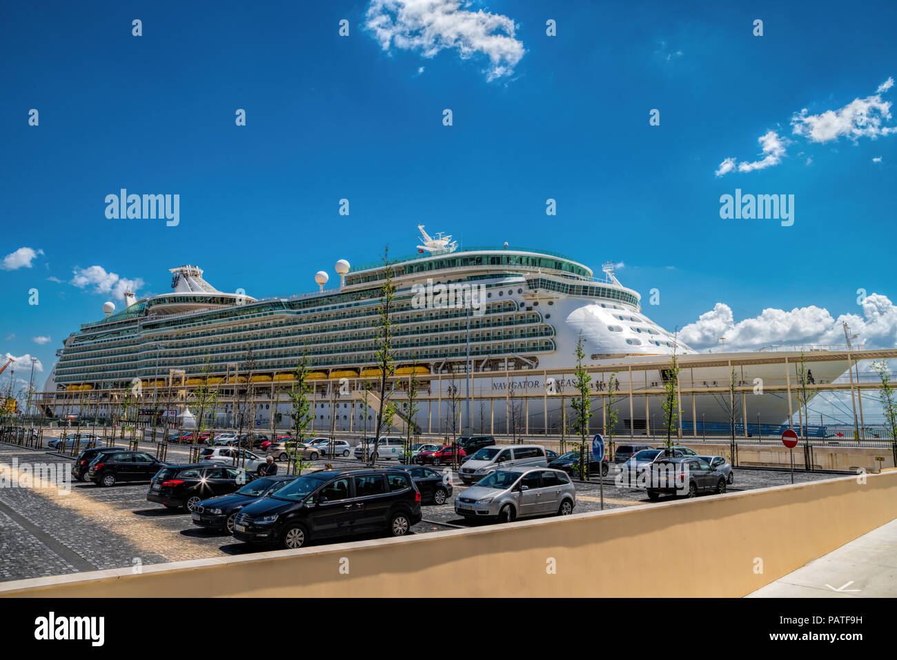 Large luxury cruise ship Navigator of the Seas docked at Lisbon - Stock Image