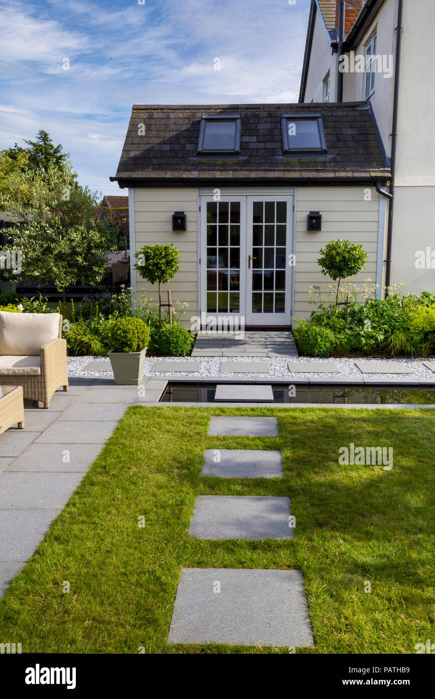 View of London Stone granite paving slabs looking towards the house exterior Stock Photo