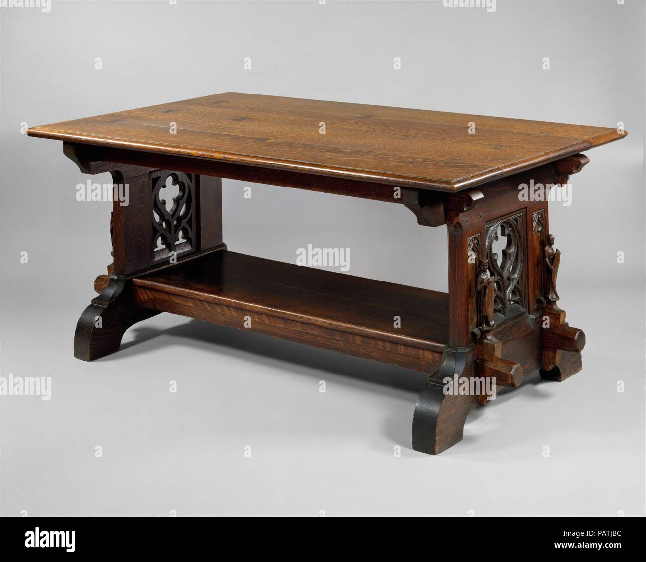 """Library Table. Culture: American. Dimensions: 29 1/2 x 66 x 39 1/2 in. (74.9 x 167.6 x 100.3 cm). Maker: Rose Valley; William Lightfoot Price (1861-1916). Date: 1904.  Rose Valley, a utopian Arts and Crafts colony, was founded in 1901 near Moylan, Pennsylvania, by William Lightfoot Price, a Philadelphia architect, with a coterie of his politically liberal colleagues, clients, and friends. Inspired by the advocates of the British Arts and Crafts movement, John Ruskin and William Morris, the community was established for the """"manufacture of ... materials and products involving artistic handicraf Stock Photo"""