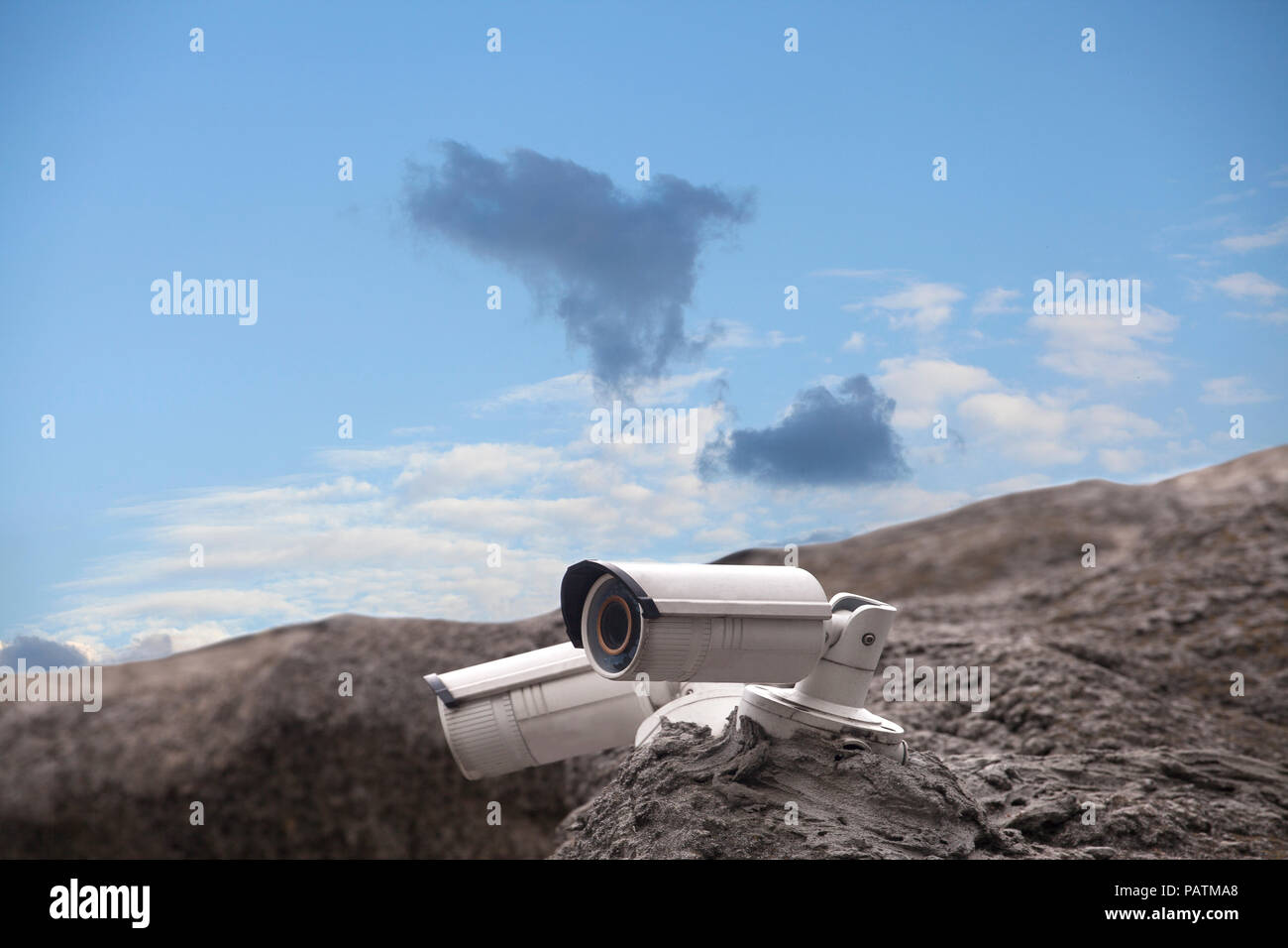 Rock Camera Surveillance : Surveillance security camera on the rock on blue sky background