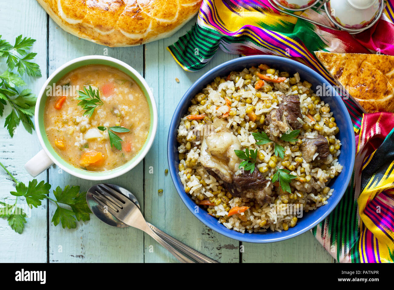 Eastern cuisine. Homemade Soup with bean mung and rice with bean mung and beef. Top view flat lay background. - Stock Image