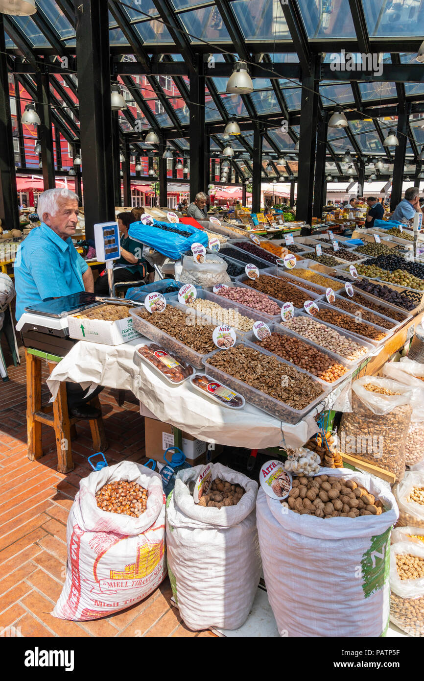Stall selling nuts and dried fruits in the newly refurbished Pazari i Ri, New bazaar area and central market, in Tirana, Albania, - Stock Image