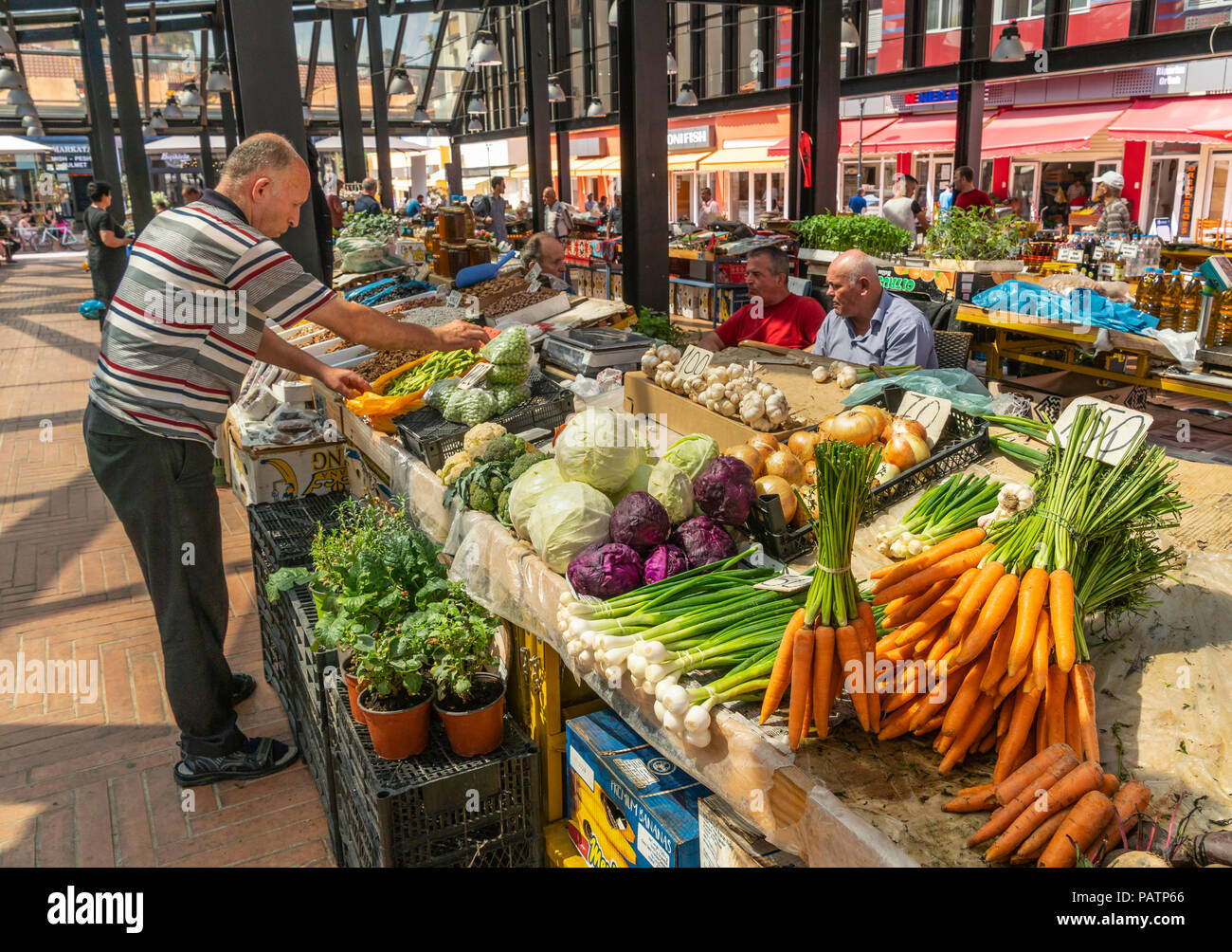 Vegetable stall in the newly refurbished Pazari i Ri, New bazaar area,  central market, in Tirana, Albania, - Stock Image