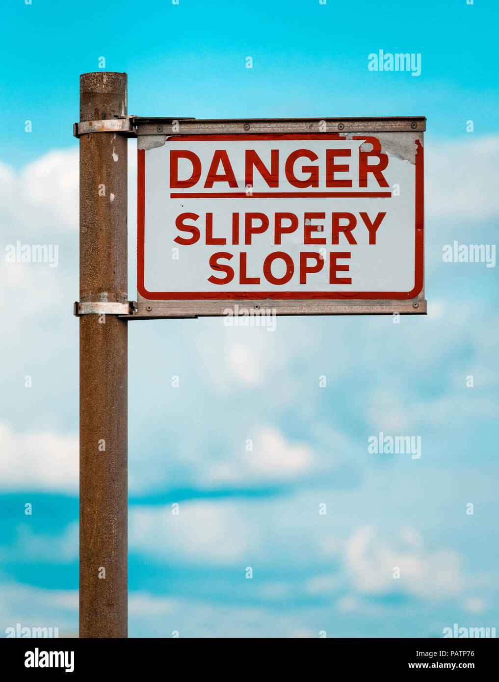 Danger Slippery Slope warning sign on Quayside Stock Photo
