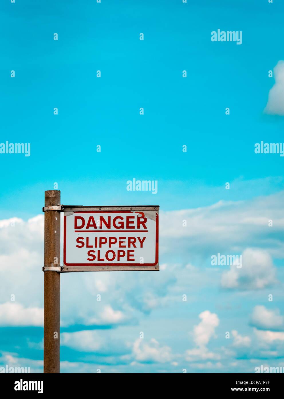 Danger Slippery Slope warning sign on Quayside - Stock Image