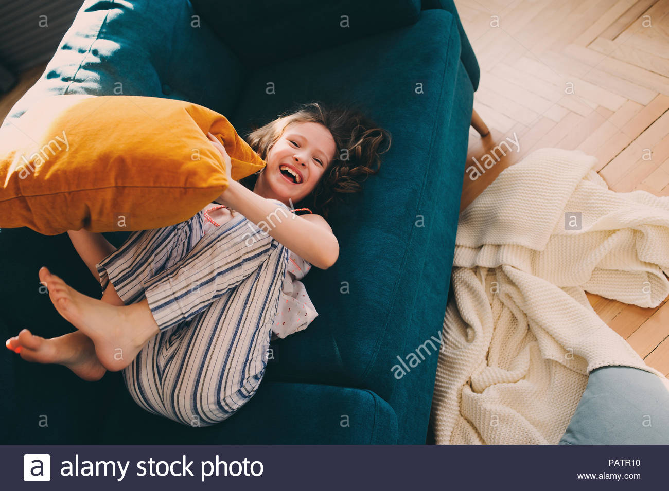A young girl having fun at home - Stock Image