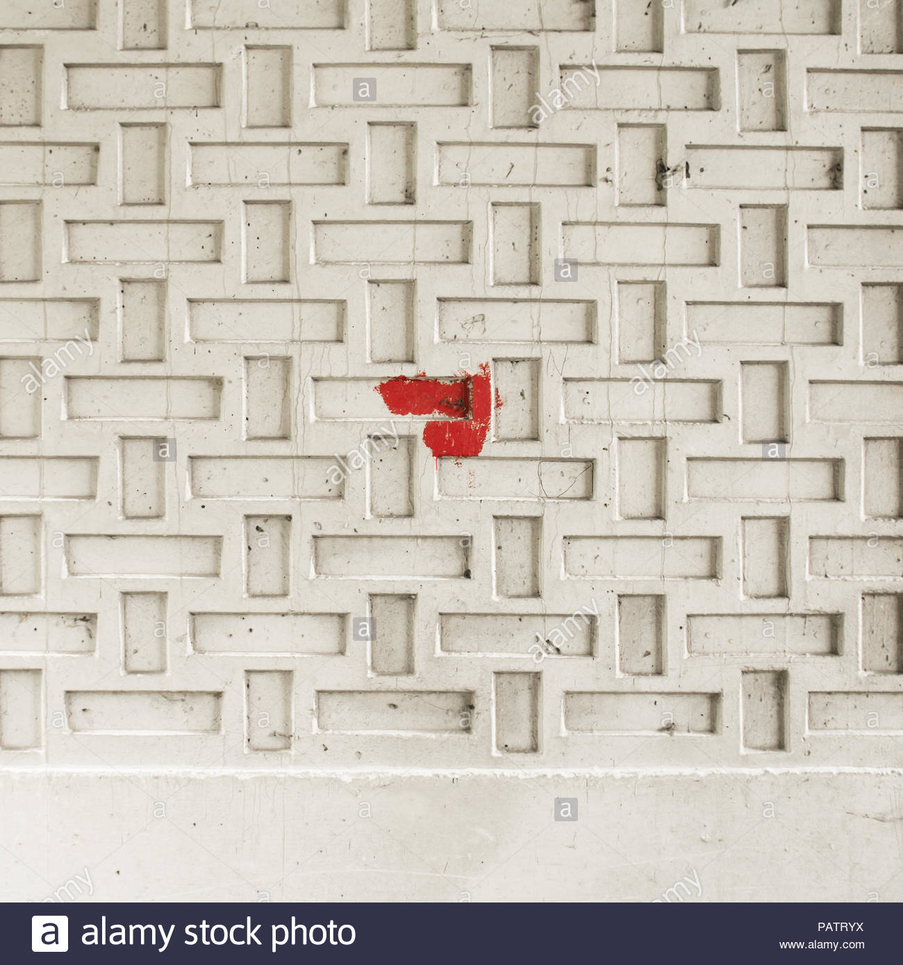 Full frame creative shot of red paint on a white wall - Stock Image
