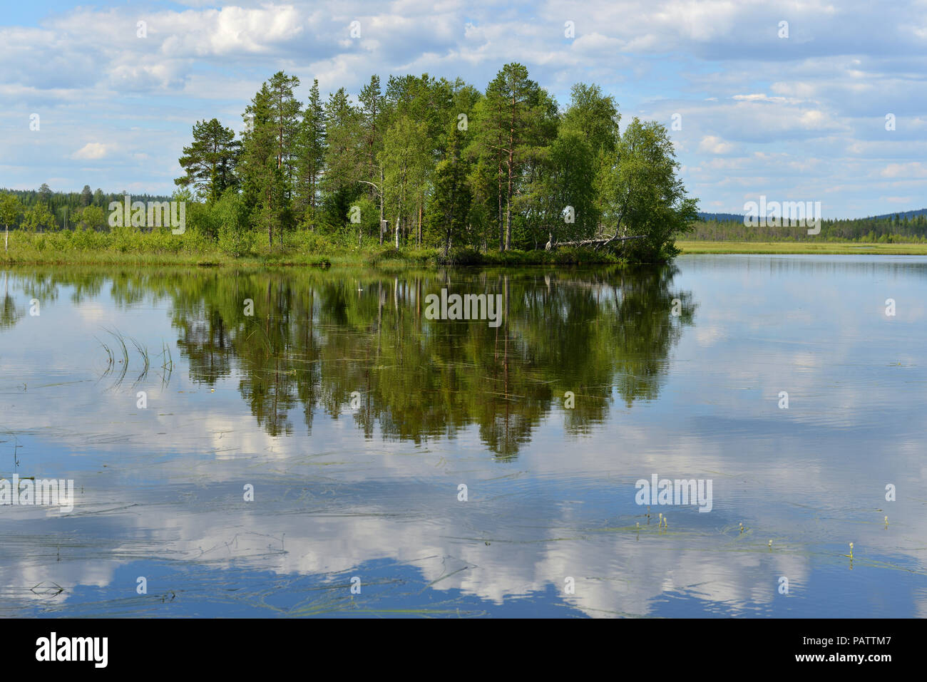 Northern landscape. Lake with reflection of clouds. Finnish Lapland - Stock Image