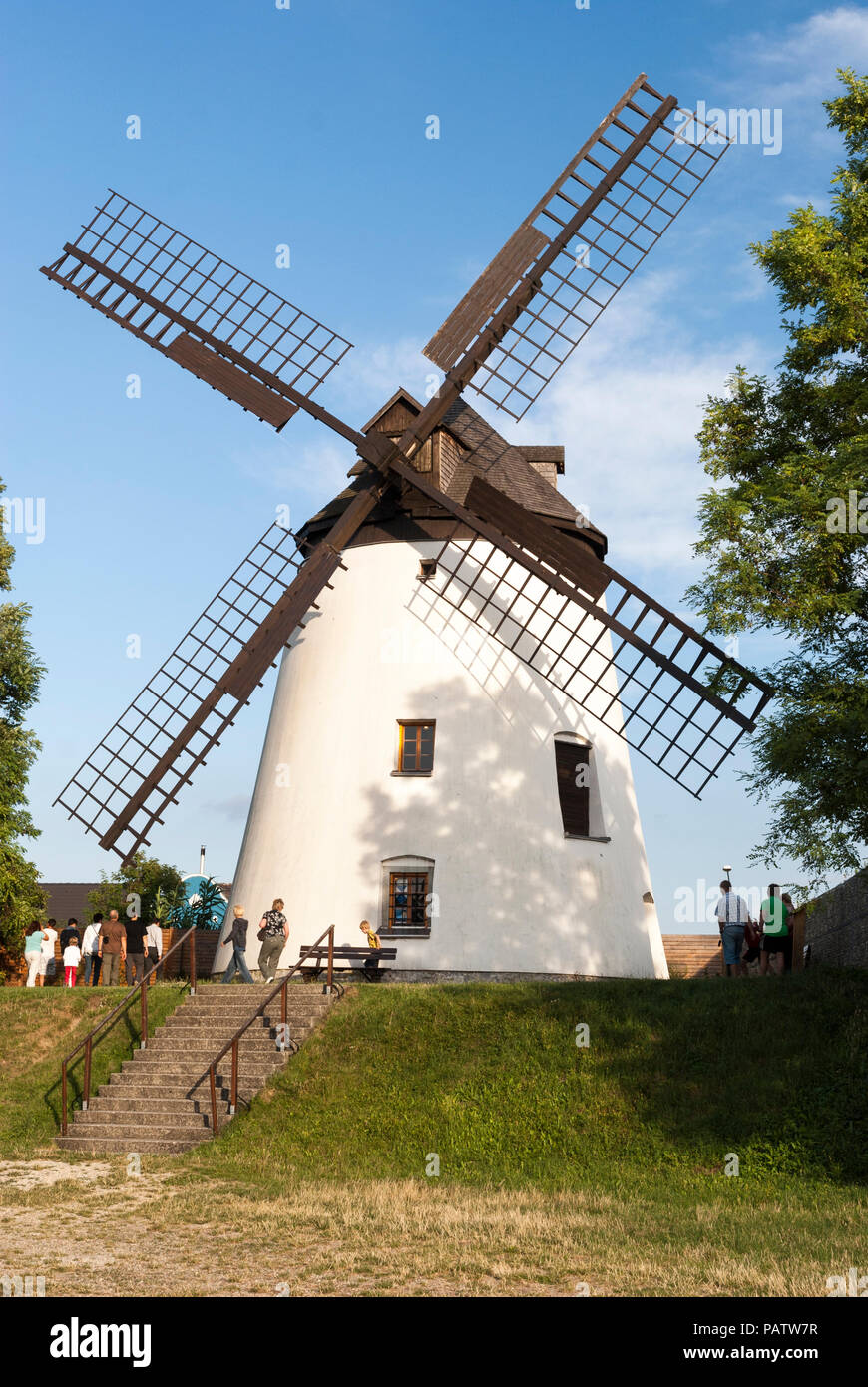 Tourists at a traditional windmill at Podersdorf am See, Neusiedler See, Burgenland, Austria - Stock Image