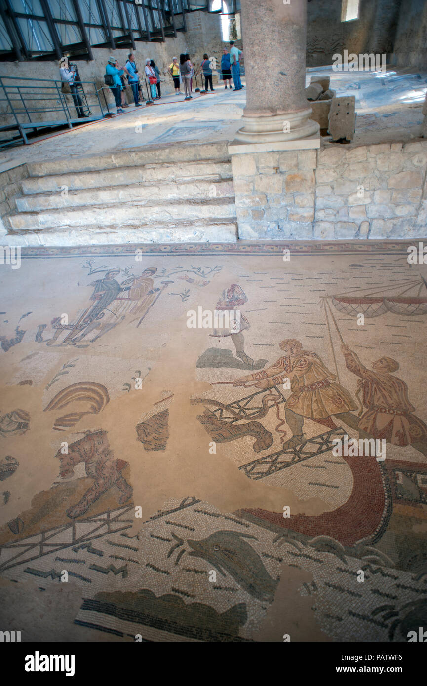 Tourists looking at the 4th century tile mosaics at Villa Romana del Casale, an ancient Roman villa located outside of Piazza Armerina in central Sici Stock Photo