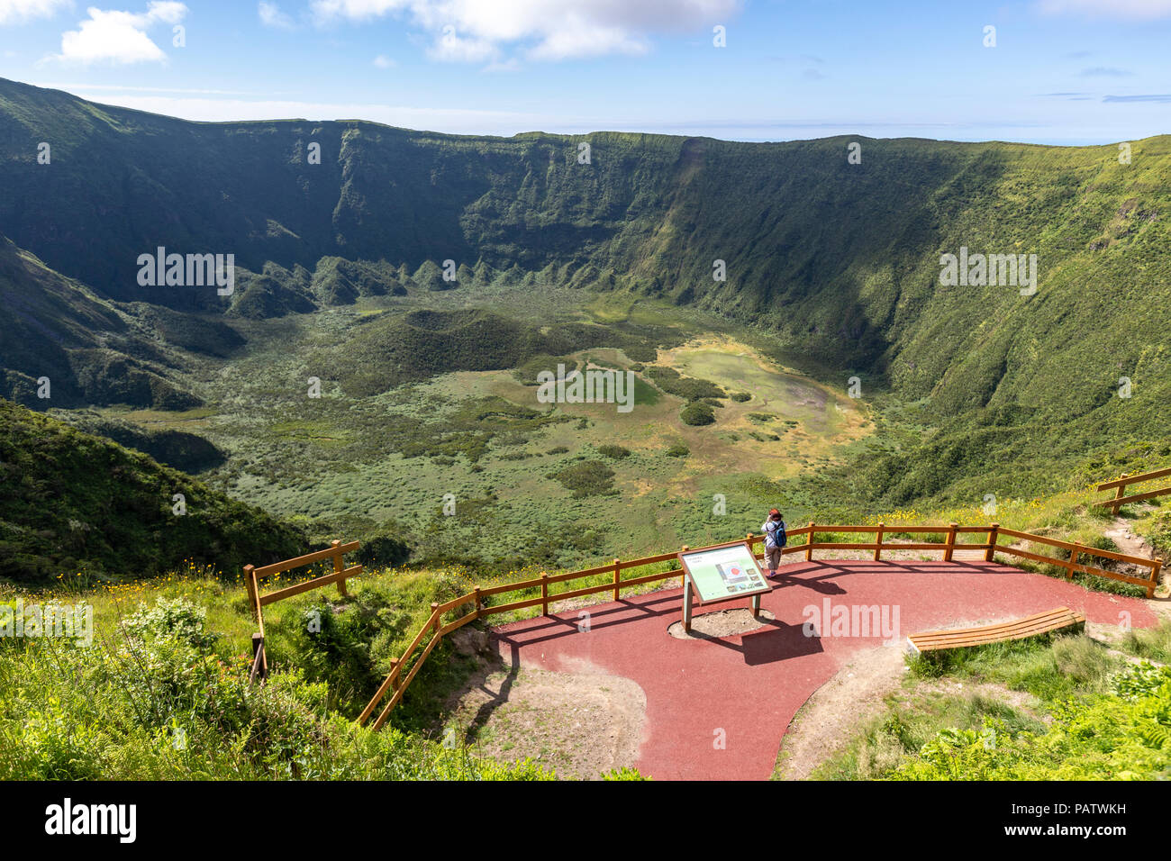 Tourist looking in the viewpoint of the Caldeira do Cabeço Gordo, stratovolcano , in Faial island, Azores, Portugal - Stock Image