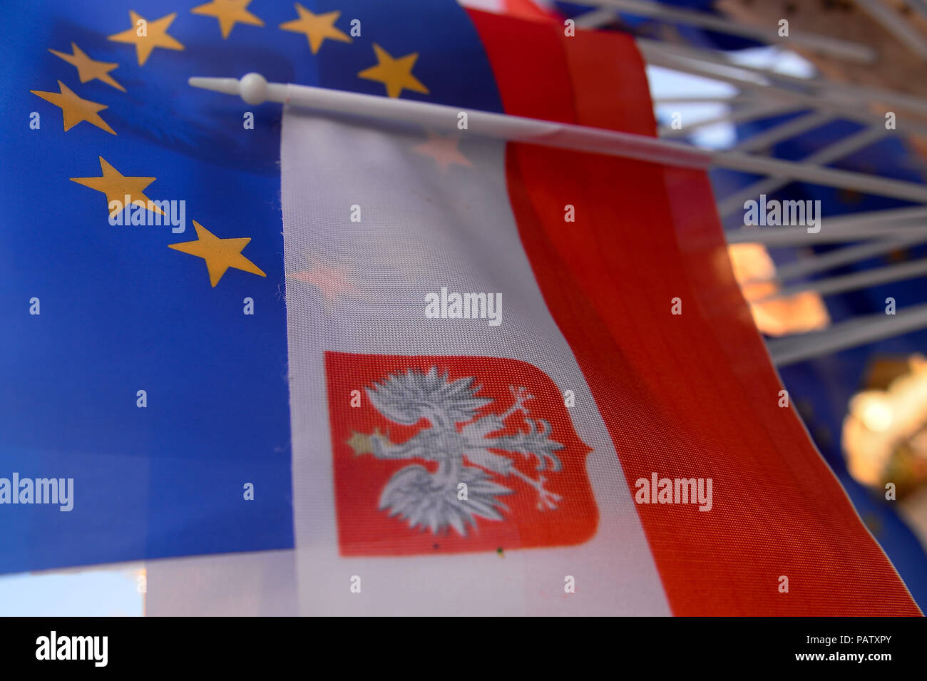 Polish and European Union flags are seen during the demonstration. A protest demanding free courts at the Main Square after Polish Senate votes another round of amends to the bills on the judiciary that makes firing and appointing judges by politicians even easier. - Stock Image