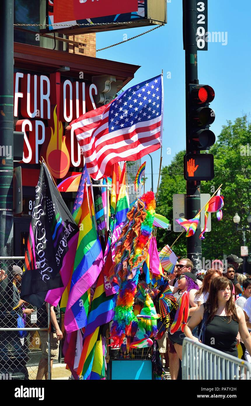 Chicago, Illinois, USA. A vendor's wares on display for parade goers on their way to the Chicago Pride Parade held each June on the city's north side. - Stock Image