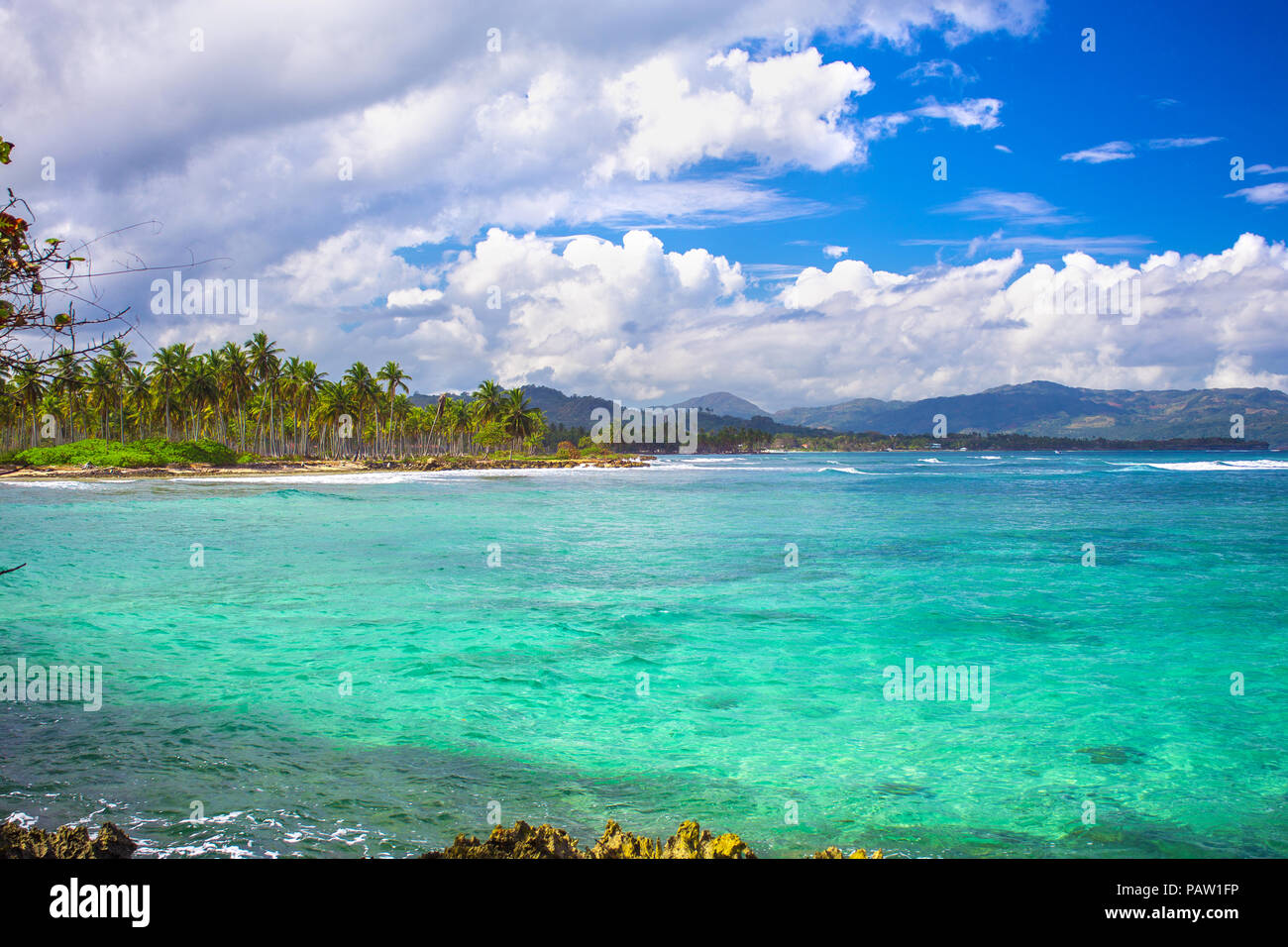 Caribbean sea surface summer wave background. Exotic water landscape with clouds on horizon. Dominican Republic nature relax. Travel tropical island r - Stock Image