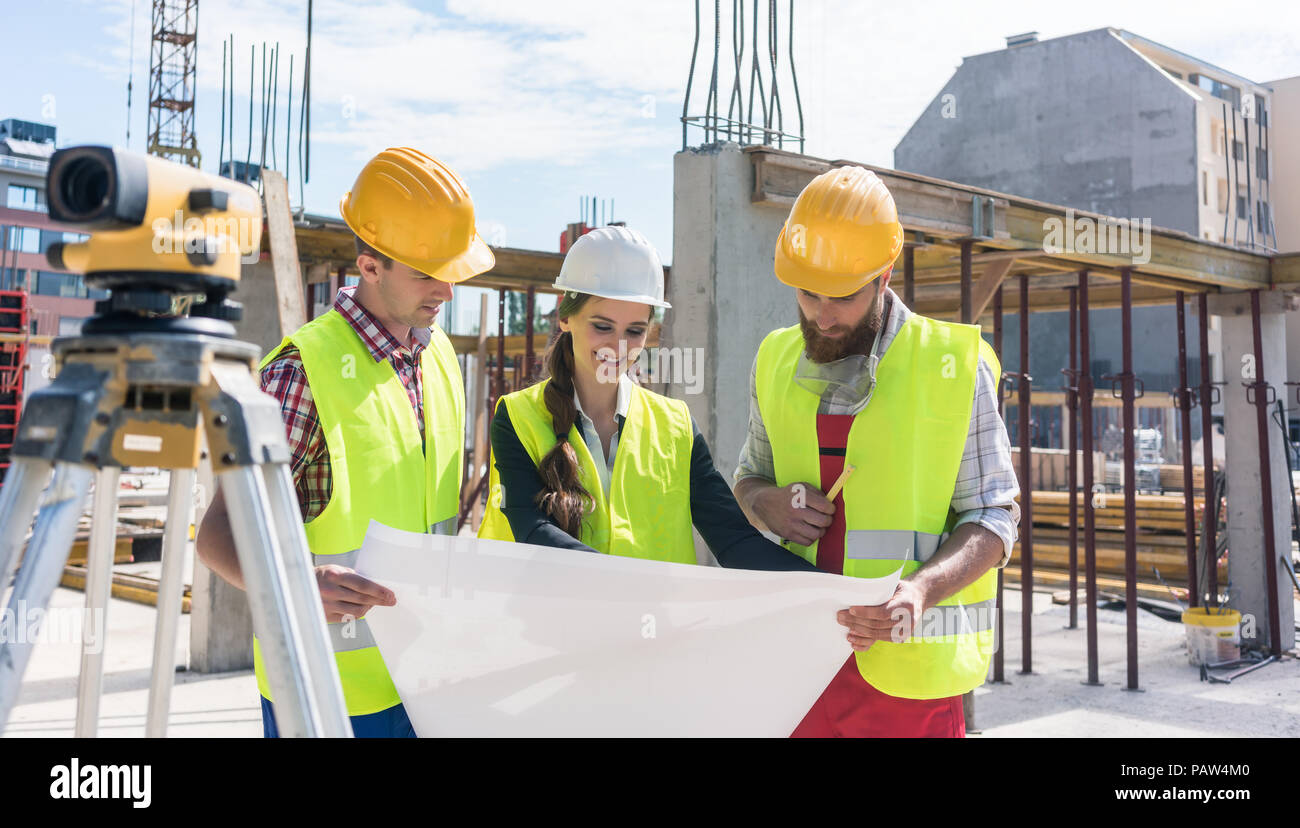 Experienced architect analyzing a blueprint on the construction experienced architect analyzing a blueprint on the construction malvernweather Image collections