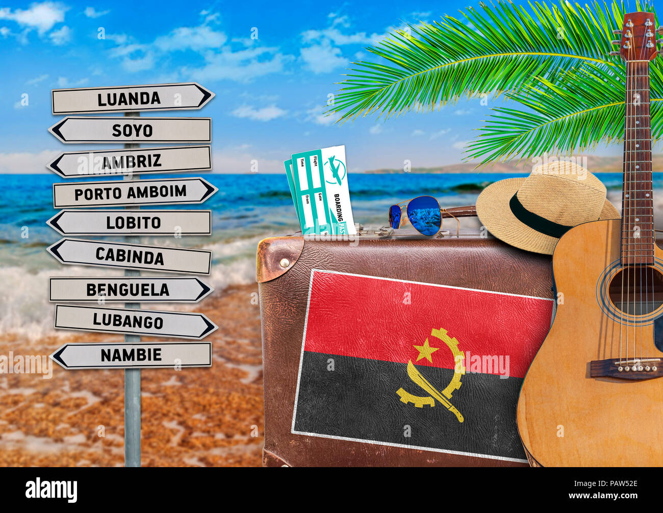 Concept of summer traveling with old suitcase and Angola town sign - Stock Image
