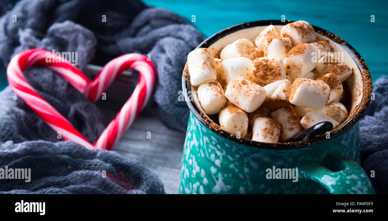 Hot chocolate with marshmallows on green background