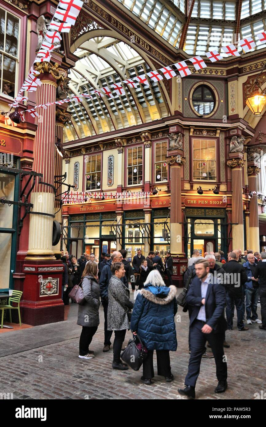 LONDON, UK - APRIL 22, 2016: People celebrate Saint George's Day in Leadenhall Market, London. Saint George is the patron saint of England. Stock Photo