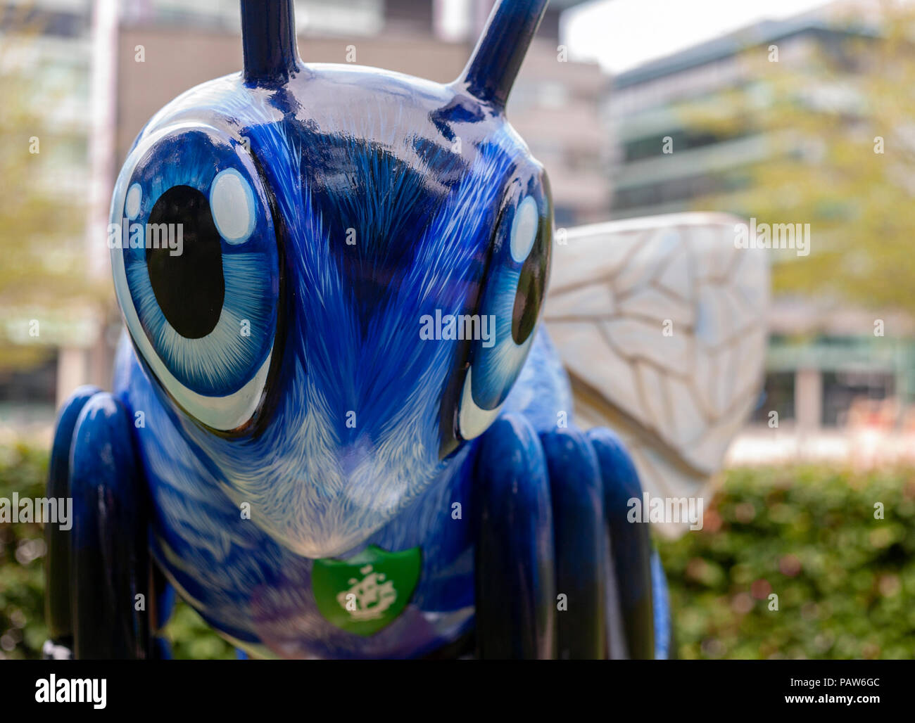 Salford Quays,Manchester, UK. 24th July 2018. Blue bee-ter is the Blue Peter bee designed and decorated by Jodie Silverman. Located near the Blue Peter garden at mediacityUK, Salford Quays, Manchester. It forms part of the Bee in the City event in support of the We Love Manchester charity Credit: Stu/Alamy Live News - Stock Image