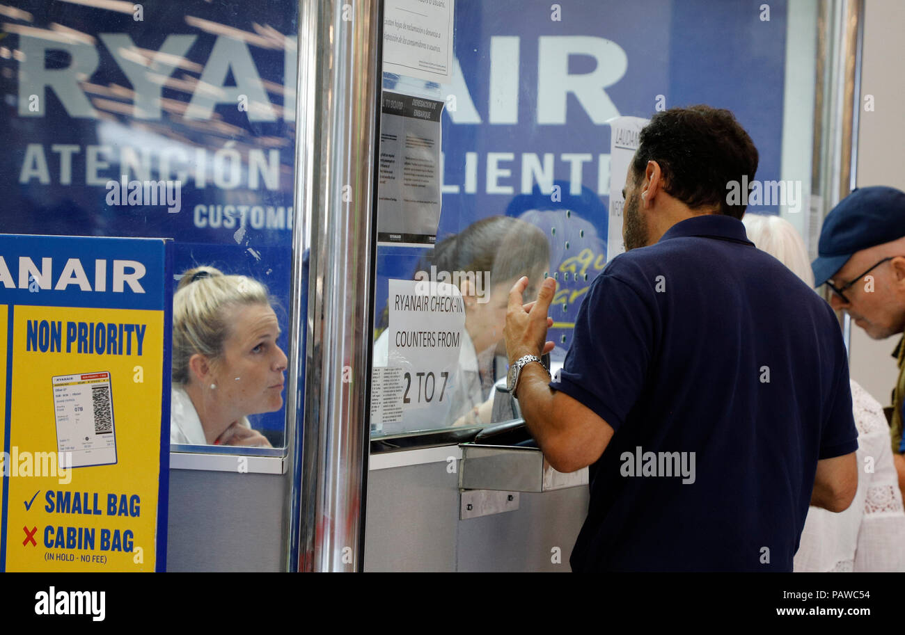 Mallorca, Spain.  25 July 2018, Mallorca, Spain: Passengers are queuing up at the Ryanair service desk at Palma de Mallorca airport. The start of a two-day strike by cabin crew at the low-cost airline Ryanair has caused great displeasure among countless travellers in several European countries. The most cancellations occurred in Spain, n. Photo: Clara Margais/dpa Credit: dpa picture alliance/Alamy Live News Stock Photo