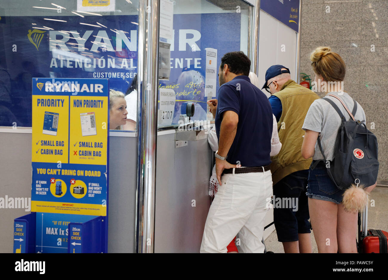 Mallorca, Spain.  25 July 2018, Spain, Mallorca, Palma: Passengers are queuing up at the Ryanair service desk at Palma de Mallorca airport. The start of a two-day strike by cabin crew at the low-cost airline Ryanair has caused great displeasure among countless travellers in several European countries. The highest number of cancellations occurred in Spain, when Ryanair cancelled 200 flights. Credit: dpa picture alliance/Alamy Live News Stock Photo