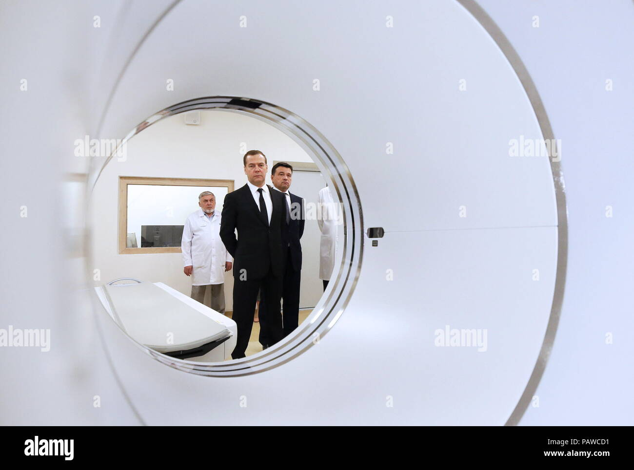 Russia. 25th July, 2018. MOSCOW REGION, RUSSIA - JULY 25, 2018: Russia's Prime Minister Dmitry Medvedev (L) and Moscow Region Governor Andrei Vorobyov (L back) visit an oncoradiological cancer centre in the city of Balashikha. Yekaterina Shtukina/TASS Credit: ITAR-TASS News Agency/Alamy Live News - Stock Image