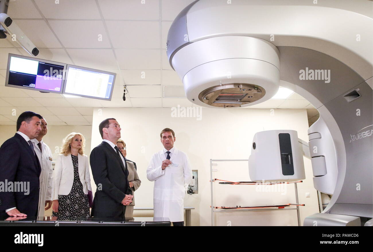 Russia. 25th July, 2018. MOSCOW REGION, RUSSIA - JULY 25, 2018: Moscow Region Governor Andrei Vorobyov, Russia's Deputy Prime Minister Tatyana Golikova, and Prime Minister Dmitry Medvedev (L-R) visit an oncoradiological cancer centre in the city of Balashikha. Yekaterina Shtukina/TASS Credit: ITAR-TASS News Agency/Alamy Live News - Stock Image