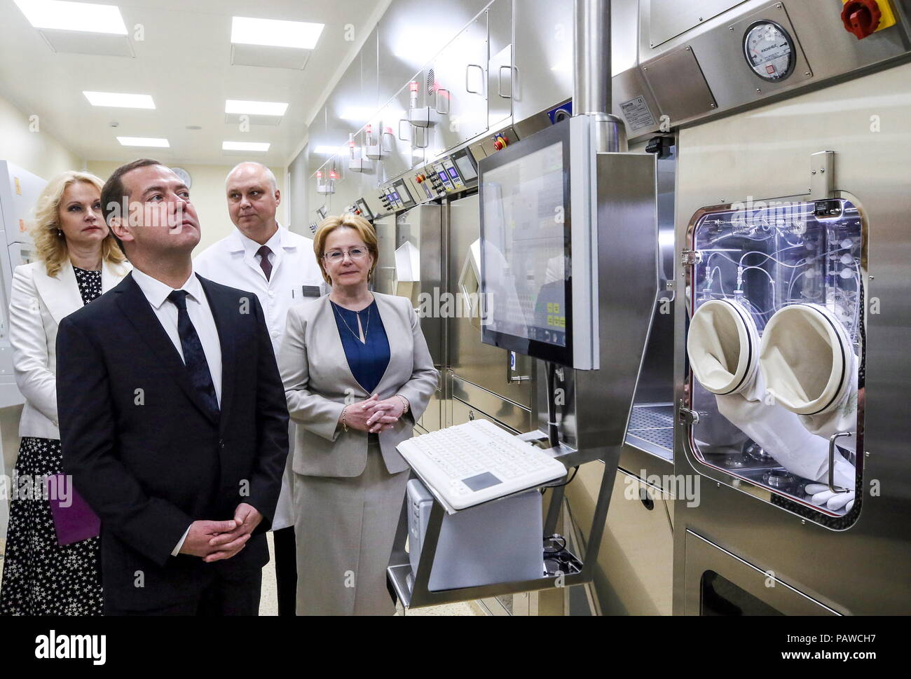 Russia. 25th July, 2018. MOSCOW REGION, RUSSIA - JULY 25, 2018: Russia's Prime Minister Dmitry Medvedev, Healthcare Minister Veronika Skvortsova (L-R front), and Deputy Prime Minister Tatyana Golikova (L back) visit an oncoradiological cancer centre in the city of Balashikha. Yekaterina Shtukina/TASS Credit: ITAR-TASS News Agency/Alamy Live News - Stock Image