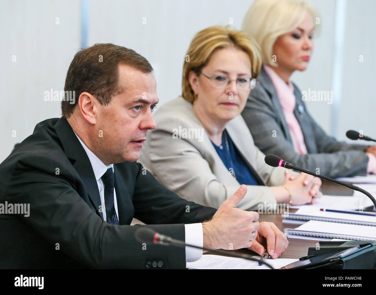 Russia. 25th July, 2018. MOSCOW REGION, RUSSIA - JULY 25, 2018: Russia's Prime Minister Dmitry Medvedev, Healthcare Minister Veronika Skvortsova, and her deputy Tatyana Yakovleva (L-R) attend a meeting on Russian citizens' cancer treatment, held at an oncoradiological cancer centre in the city of Balashikha. Yekaterina Shtukina/TASS Credit: ITAR-TASS News Agency/Alamy Live News - Stock Image