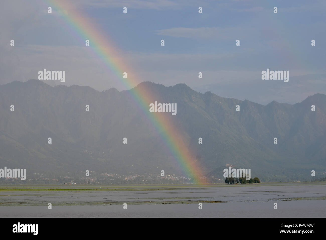 July 25, 2018 - Budgam, Jammu And Kashmir, India - A rainbow is seen over the Zabrwan hills..On a rainy day around Dal Lake in Srinagar, the summer capital of Indian administered Kashmir, India. (Credit Image: © Masrat Zahra/SOPA Images via ZUMA Wire) Stock Photo