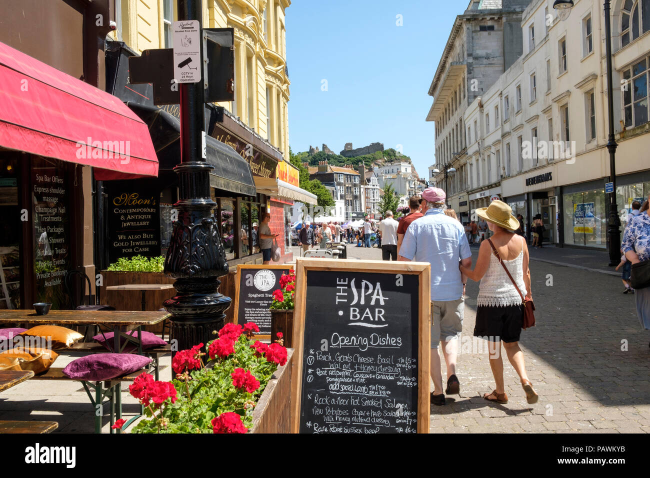 Cafes in Robertson Street, Hastings, looking towards the Castle, East Sussex, UK - Stock Image