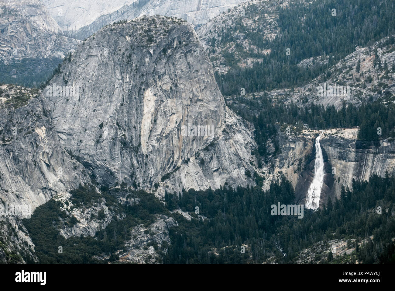 Granite Valley and Dome Landscape, With Flowing Nevada Falls - Taken from Wawona (Glacier Point Road) - Yosemite National Park Stock Photo