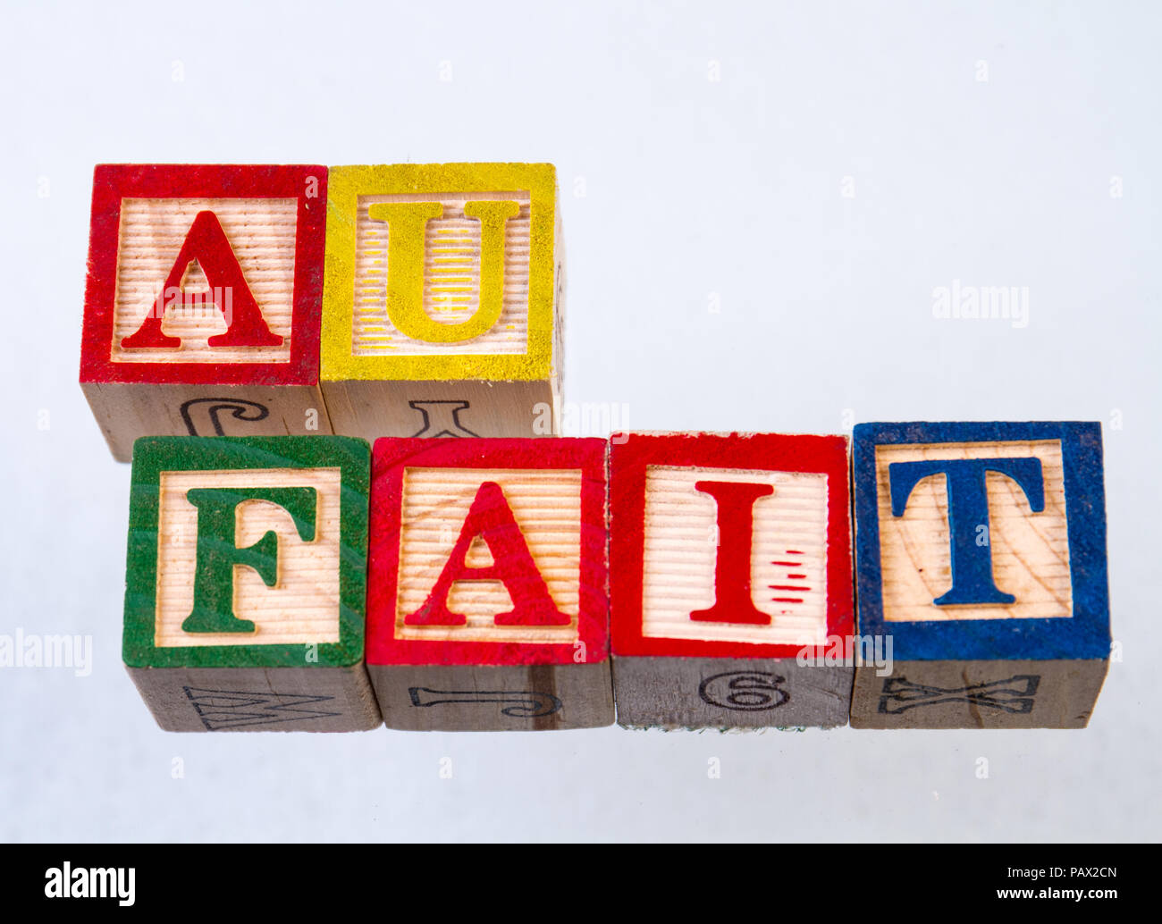 The term au fait displayed visually on a white background using colorful wooden toy blocks - Stock Image