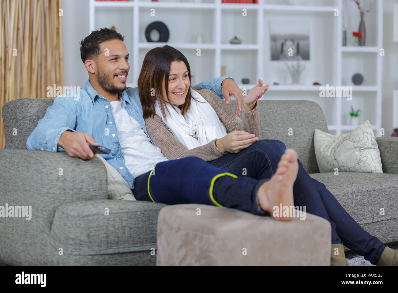 Incredible Couple On Sofa Man Wearing Leg Support Stock Photo Theyellowbook Wood Chair Design Ideas Theyellowbookinfo