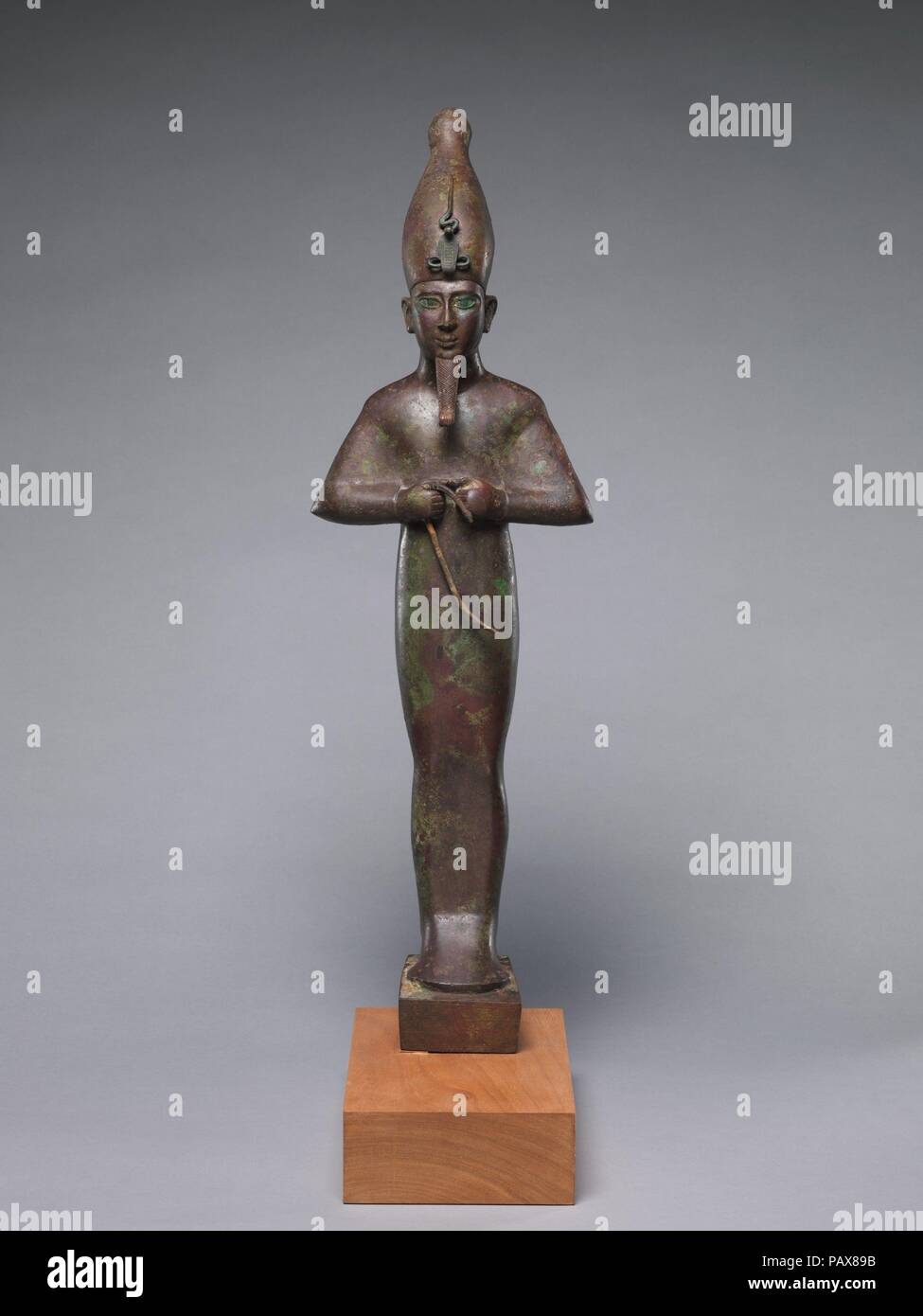 Osiris inscribed for Harkhebit, son of Padikhonsu and Isetempermes. Dimensions: H. 76 cm (29 15/16 in.); H. without tang 72 cm (28 3/8 in.); W. 22.3 cm (8 3/4 in.); D. 18.5 cm (7 5/16 in.). Date: 600-300 BC.  During the first millennium B.C. Osiris's cult became dominant and was observed in seemingly every temple in the land. This large Osiris was dedicated somewhere at Memphis. After a period, which might even be hundreds of years, it was removed with other figures - including 10.175.131, .132 and .134 - for  respectful burial within the temple precincts.  The statue's facial features - uptur Stock Photo