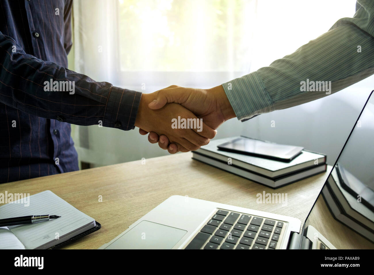 Business handshake. Business people shaking hands, finishing up a meeting,Success agreement negotiation. - Stock Image