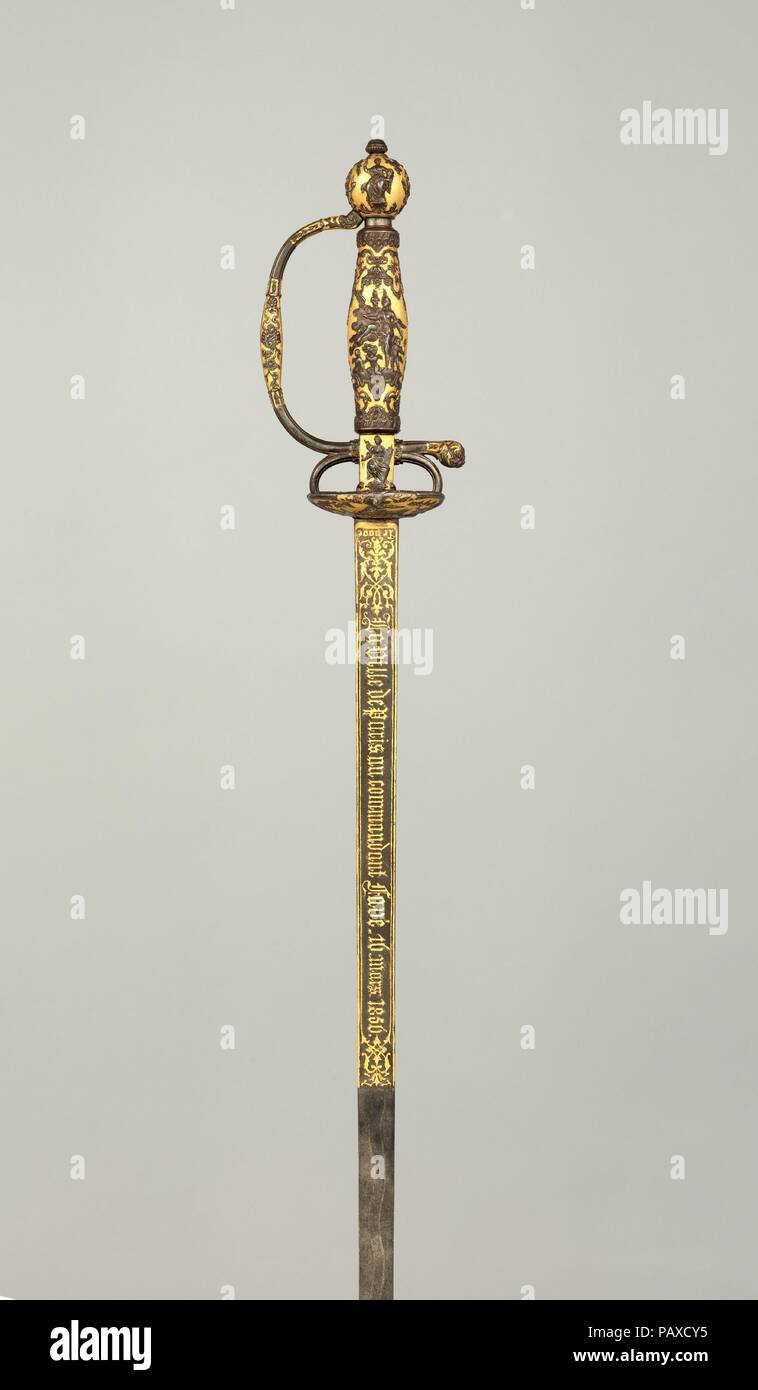 Smallsword Presented by the City of Paris to Commandant Ildefonse Favé (1812-1894). Culture: French. Dimensions: L. 36 in. (91.5 cm); L. of blade 30 1/8 in. (76.6 cm); W. 3 1/4 in. (8.3 cm); Wt. 1 lb. 0.6 oz. (470.6 g). Hilt Maker: Paul Bled (French, Falaise 1807-1881). Manufacturer: Lepage-Moutier (French 1842-1868). Date: dated 1856.  This smallsword was presented by the City of Paris to Commandant Ildefonse Favé to commemorate his official announcement to the city of the birth of Napoléon, Prince Imperial (1856-1879), son of Emperor Napoleon III, on March 16, 1856, as indicated by the inscr Stock Photo