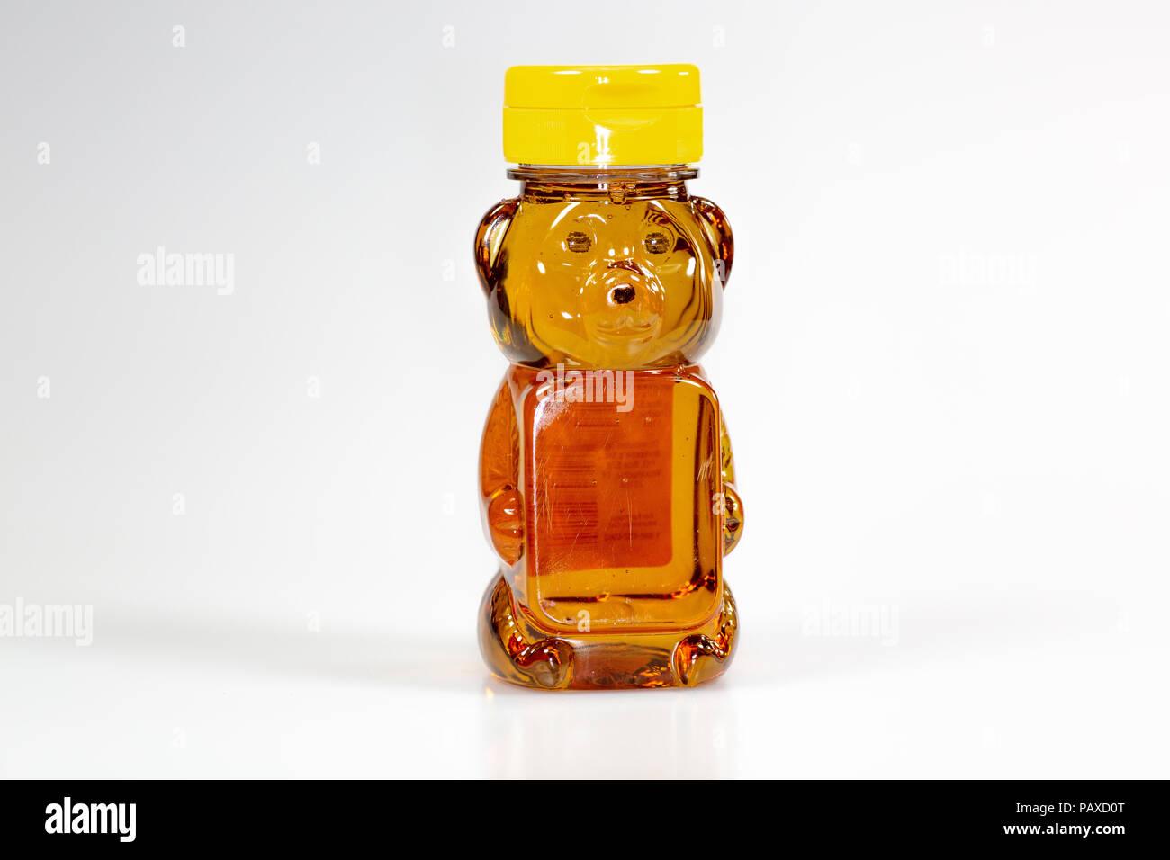 A bear shaped plastic bottle full of honey waiting to be used - Stock Image