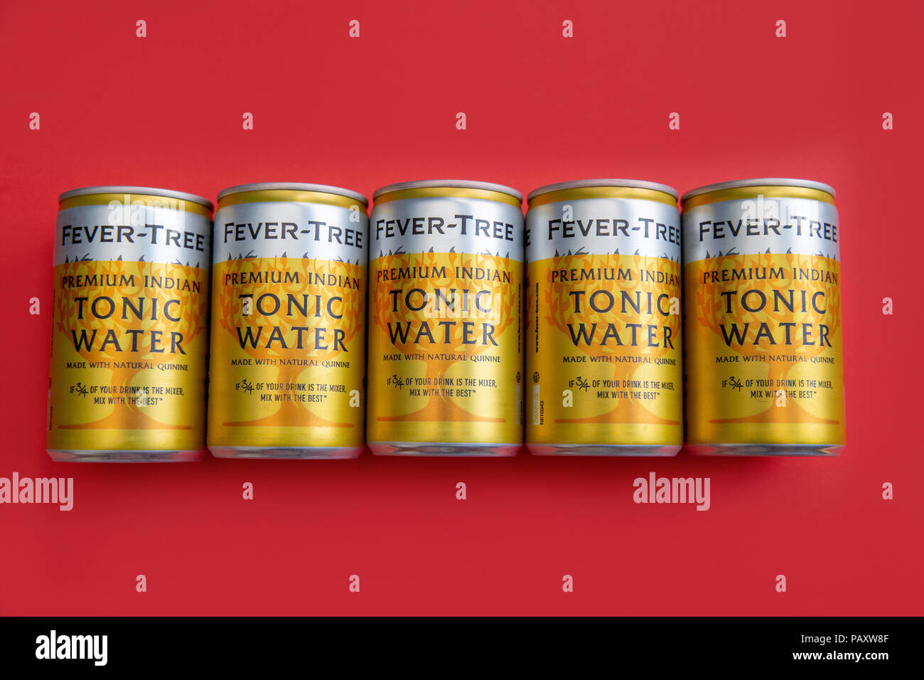 LONDON - July 18, 2018: Fever Tree tonic water cans on red background - Stock Image