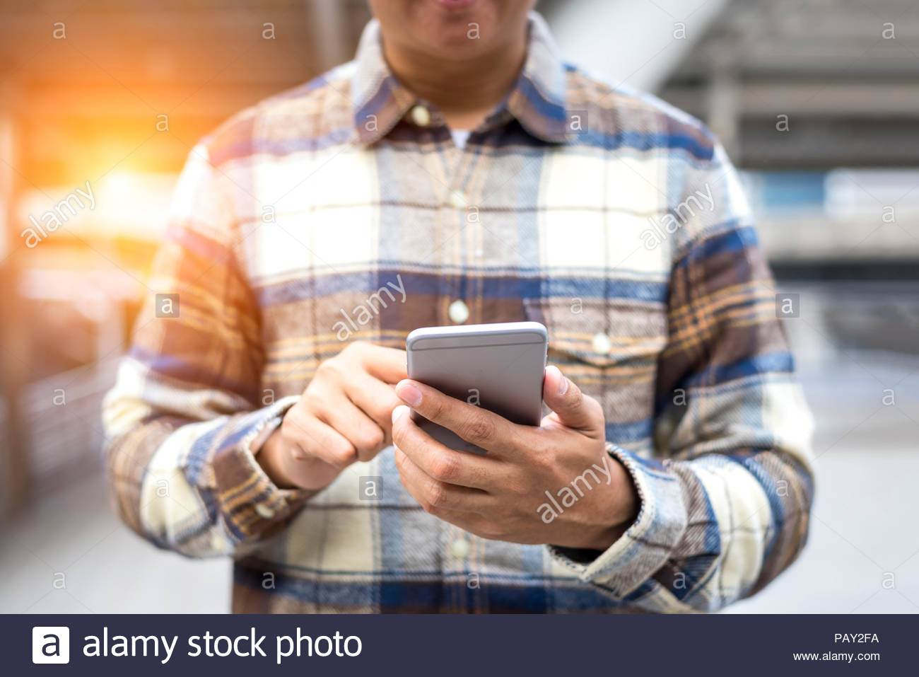 Man holding smartphone for searching Internet of Things