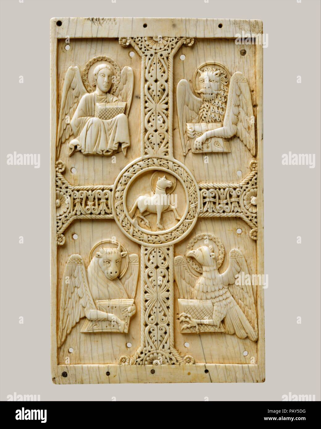 Plaque With Agnus Dei On A Cross Between Emblems Of The Four