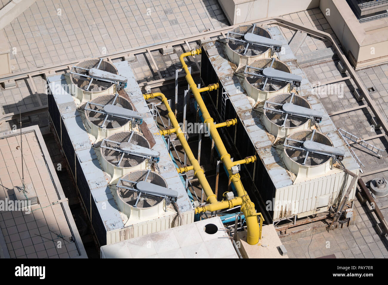 Air compressors and pipe system on the roof of a building Stock Photo