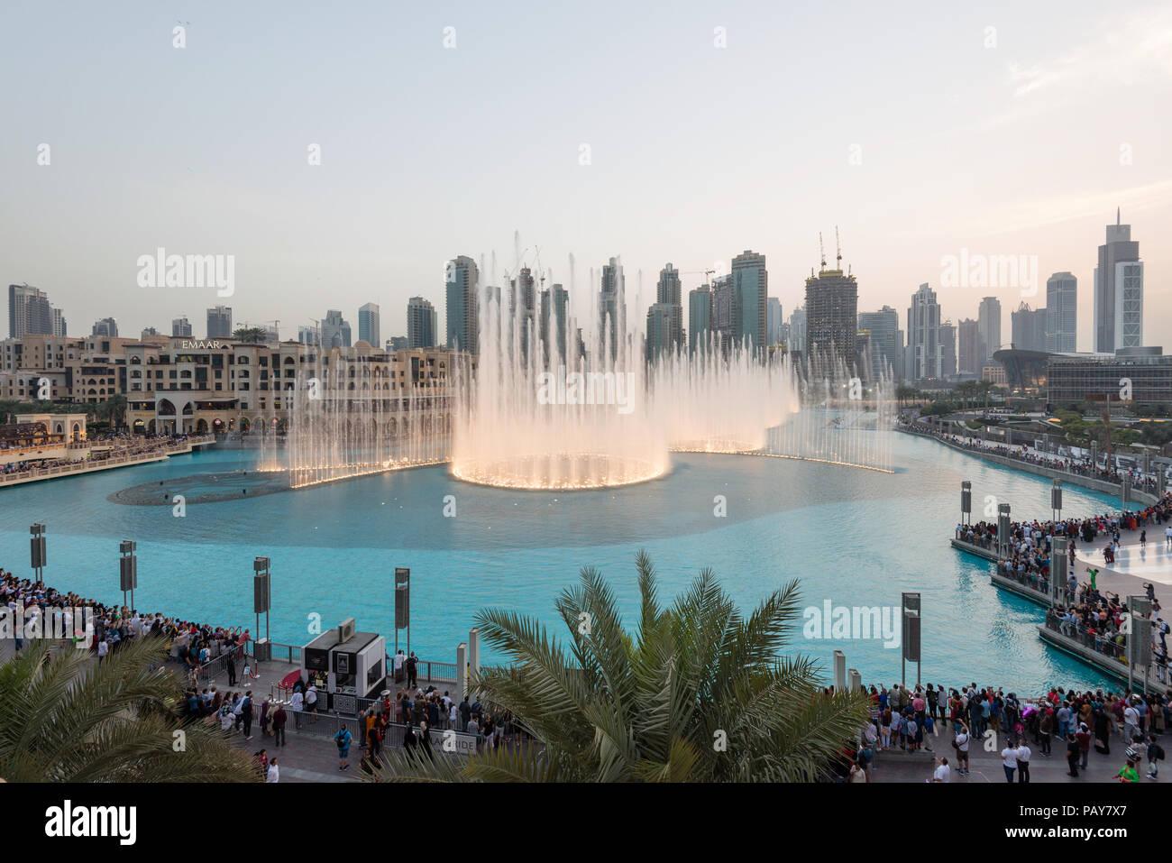 DUBAI, UAE - February 14, 2018:  The Dubai Fountain display in front of the Burj Khalifa, tallest building in the world, in downtown Dubai, UAE - Stock Image