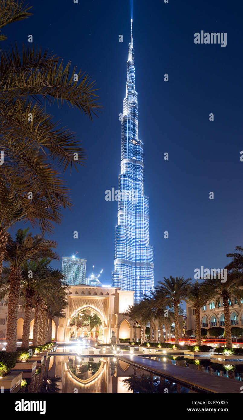 DUBAI, UAE - February 15, 2018: Burj Khalifa, with 828m height the tallest tower in the world, reflecting on the   Dubai Fountain lake outside the Dub - Stock Image
