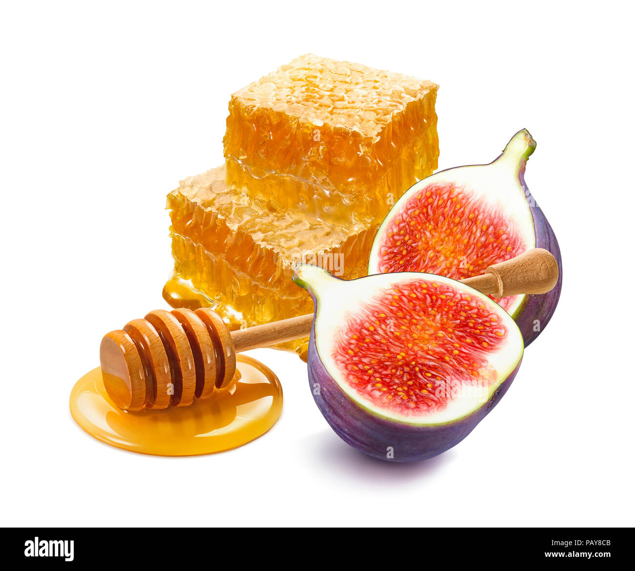 Pile of honeycomb pieces, honey dipper and fresh cut fig isolated on white background. Horizonal composition with clipping path - Stock Image