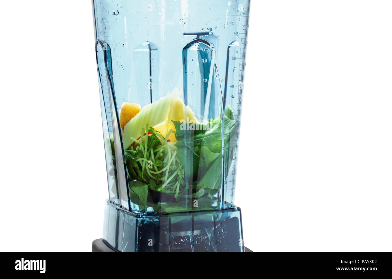 Healthy smoothie for weight loss. Ingredients for healthy smoothie in blender with white background. Ingredients such as: spinach, celery, wheat germ. - Stock Image