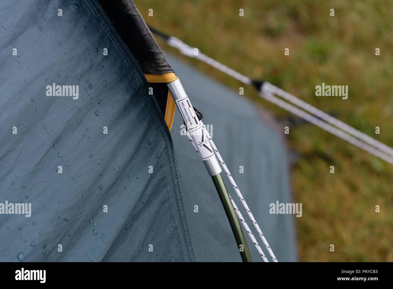 A broken tent pole repaired using an aluminium repair sleeve - Stock Image